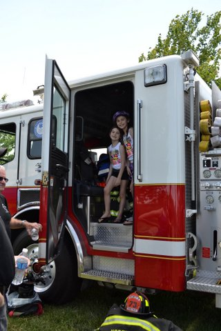 Residents exploring the fire truck.