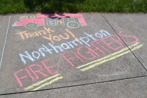 Chalk art thanking the volunteer fire fighters